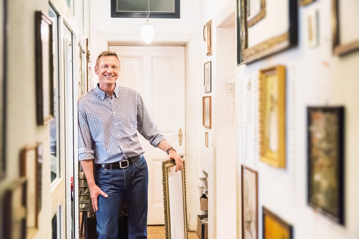 Art collector or antique Shop Owner in his apartment corridor.